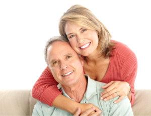 elderly couple smiling