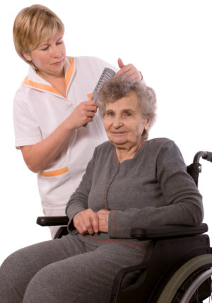 caregiver grooming elderly woman's hair